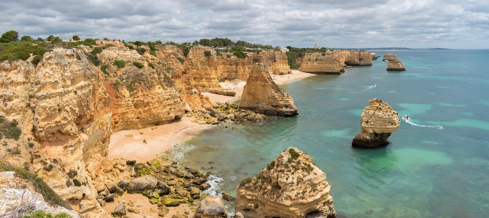 Panorama of Praia da Marinha on the south coast of Portugal in the Algarve on a cloudy day royalty free stock photography