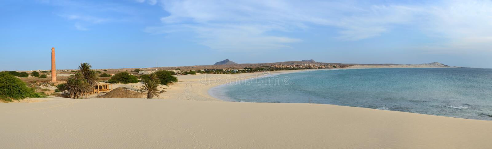 Panorama of Praia de Chaves Beach, Boa Vista, Cape Verde. Panorama of Praia de Chaves Beach in Boa Vista, Capo Verde, at Sunset, with the tall chimney from an royalty free stock photo