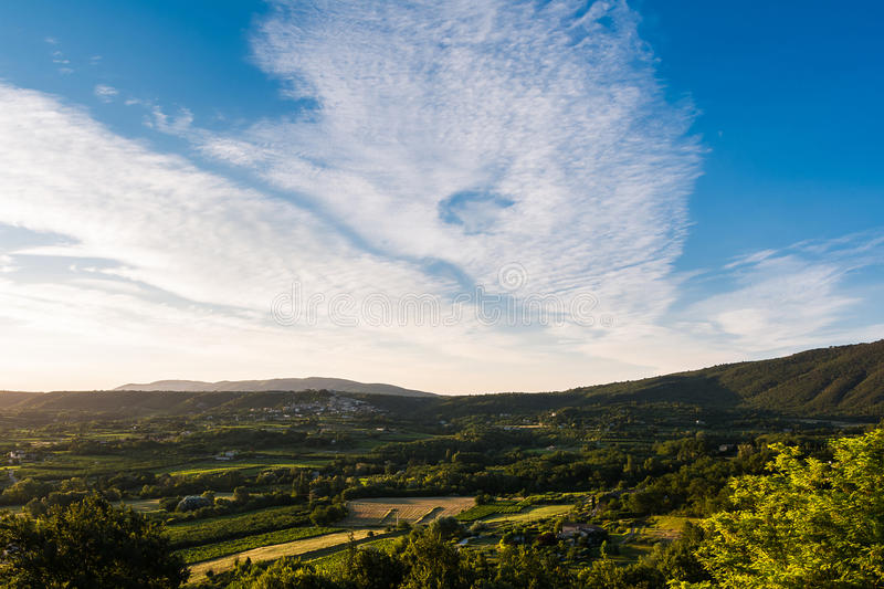 Panorama of the Provencal campaign at the golden hour. Summer blue sky on golden hours royalty free stock image