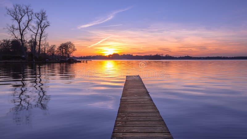 Panorama of purple Sunset over Serene Lake stock photo