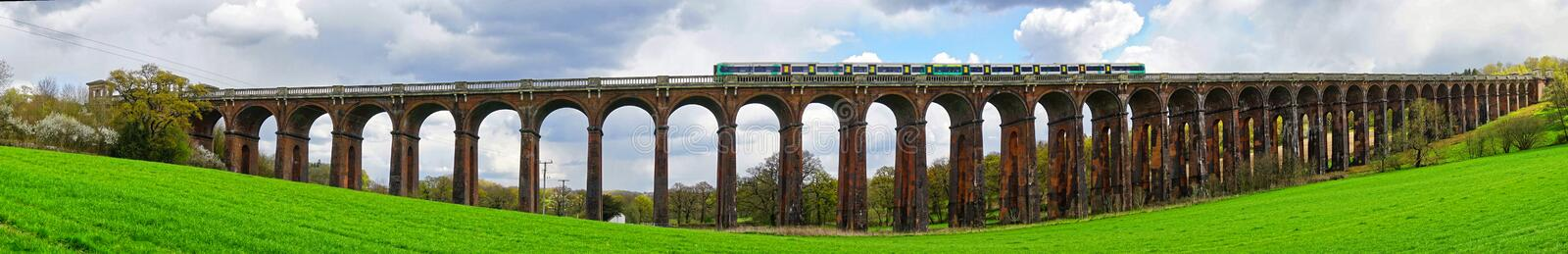 Panorama of Railway Viaduct with Train stock image