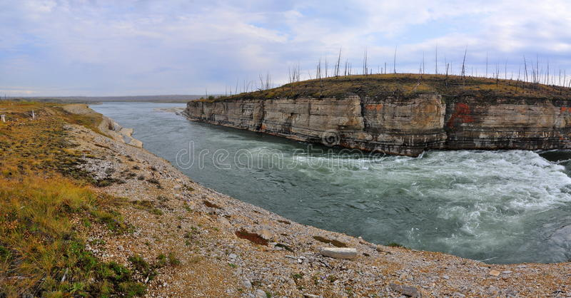 Panorama of rapid in a rocky canyon. stock image