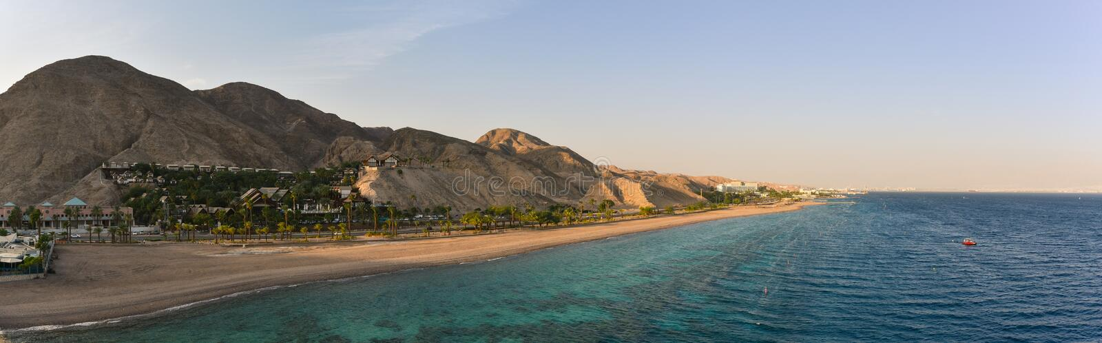 Panorama of the Red Sea coastline Eilat Israel. Panoramic view on the Red Sea coastline at famous touristic resort in Eilat, Israel royalty free stock image