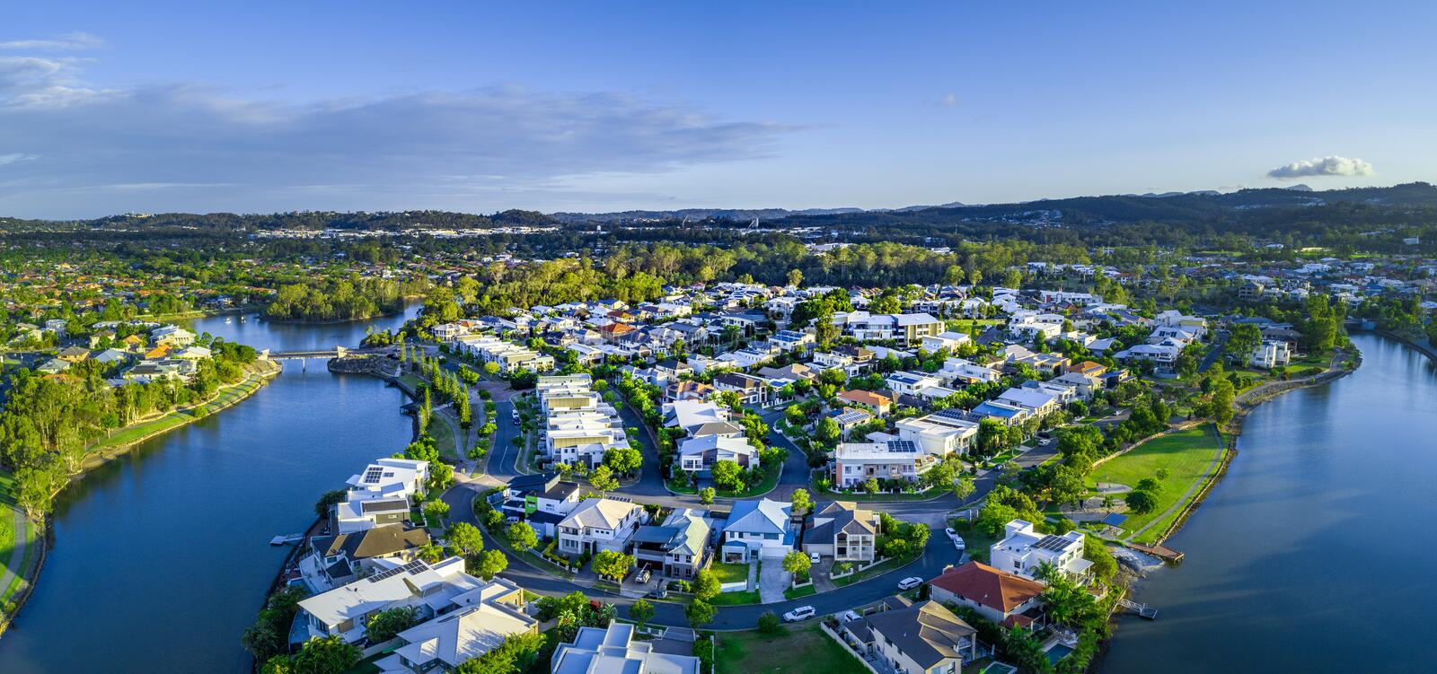 Panorama of Reedy creek and luxury houses. Aerial panorama of Reedy creek and luxury houses. Varsity Lakes, Gold Coast, Queensland, Australia royalty free stock image