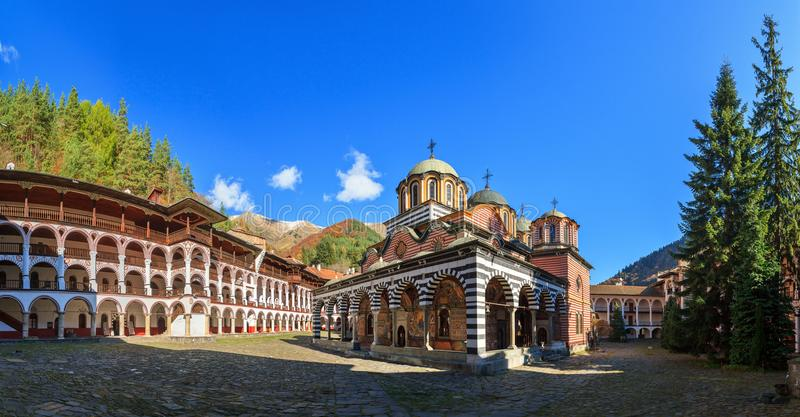 Panorama Rila monastery blue sky. Beautiful panoramic panorama of the Orthodox Rila Monastery, a famous tourist attraction and cultural heritage monument in the stock image