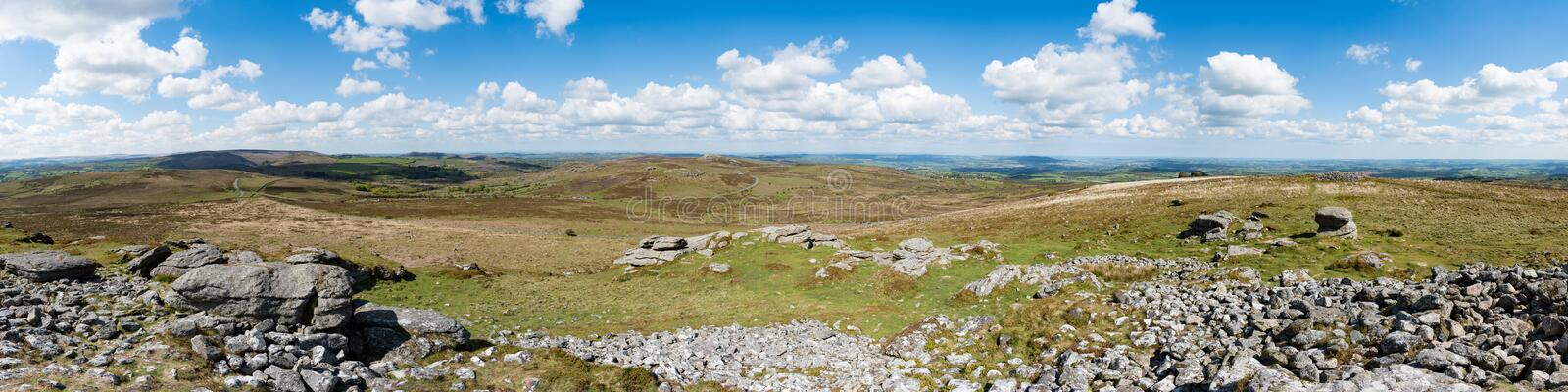 Panorama from Rippon Tor of, from left to right, Emsworthy Rocks, Saddle Tor and Haytor across moorland of Dartmoor National Park, stock images