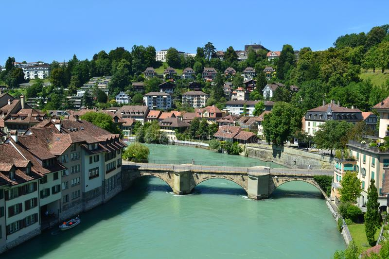 Panorama of the river Aare in Bern, Switzerland. Panorama of the river Aare in Bern, azure water, bridge, houses, blue sky stock photography