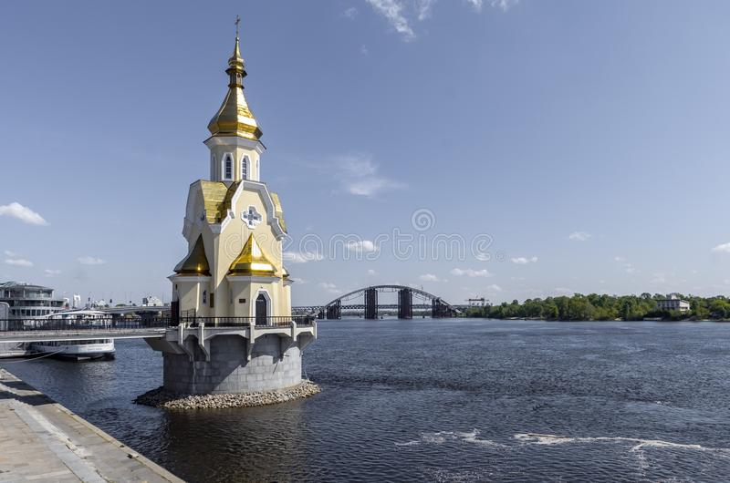 Panorama of the river dnepr with bridges and church at Kiev. Panorama of the city Kiev on summer day. St. Andrew`s Church stands on the Dnieper. Bridges across stock photography