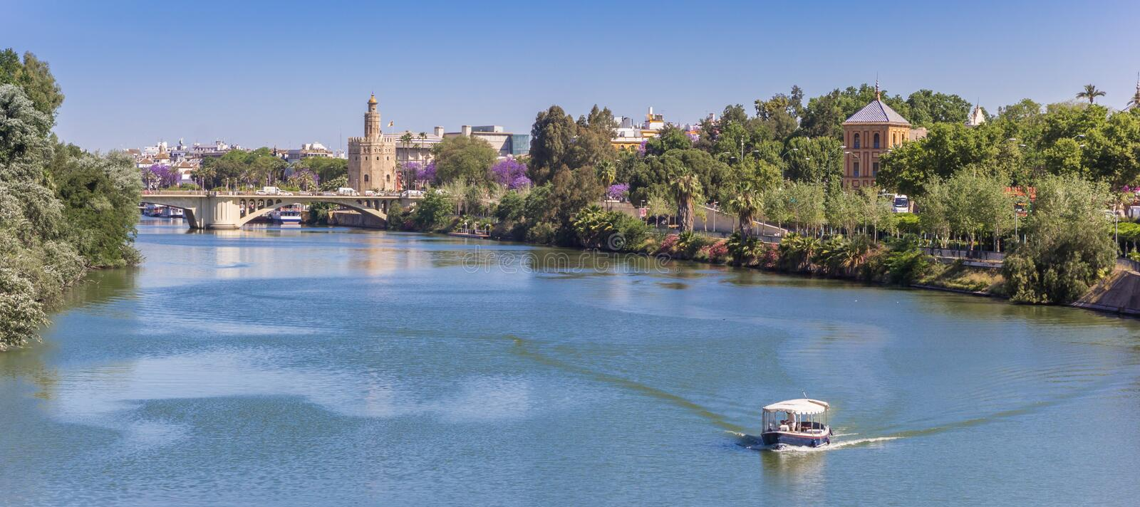 Panorama of the river Guadalquivir and the golden tower in Sevilla. Spain royalty free stock photo
