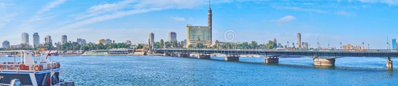 Panorama of Qasr El Nil bridge, Cairo, Egypt. Panorama of rivrside area with a view on Qasr El Nil bridge, stretching across the Nile river to Gezira Island royalty free stock photos