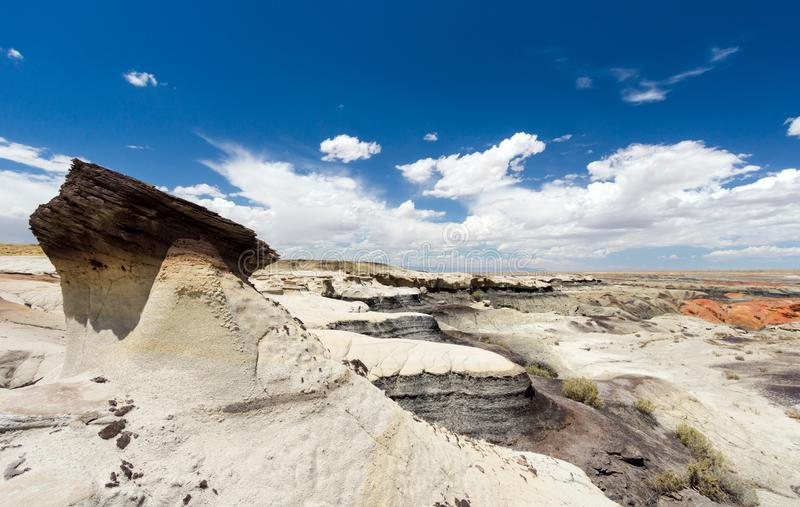 Panorama rock desert landscape in northern New Mexico. In the Bisti/De-Na-Zin Wilderness Area with washed out hoodoo rock formations under a blue sky stock photos