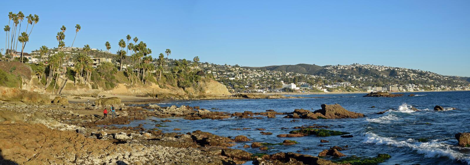 Panorama of Rock Pile Beach, Heisler Park and Laguna Beach, California. The image is a panorama view of Rock Pile Beach, Heisler Park (left above bluff) and the royalty free stock images
