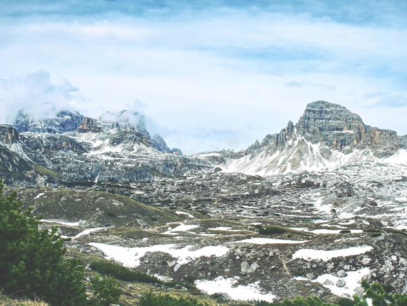 Panorama of a rocky mountain valley with a sharp peaks stock photography