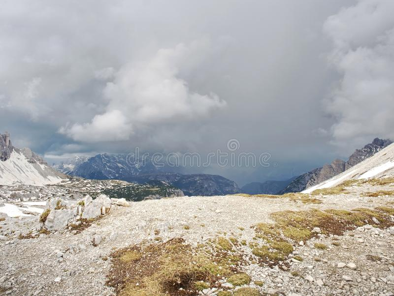 Panorama of a rocky mountain valley with a sharp peaks. Close clouds above royalty free stock photo