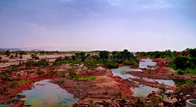 Panorama of rocky pond on Adrar plateau, Mauritania. Panorama of rocky pond at Adrar plateau, Mauritania royalty free stock images
