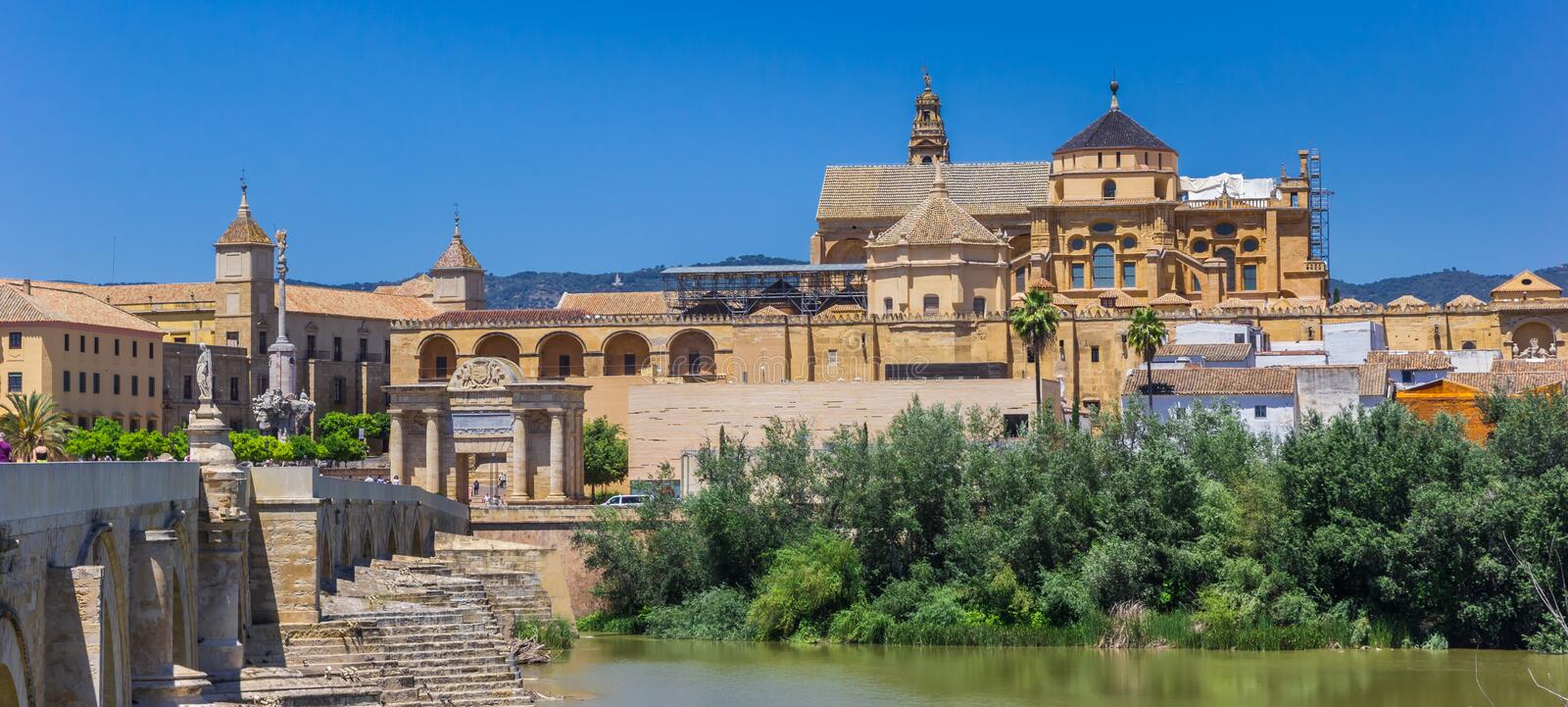 Panorama of the roman bridge and mosque cathedral in Cordoba royalty free stock image