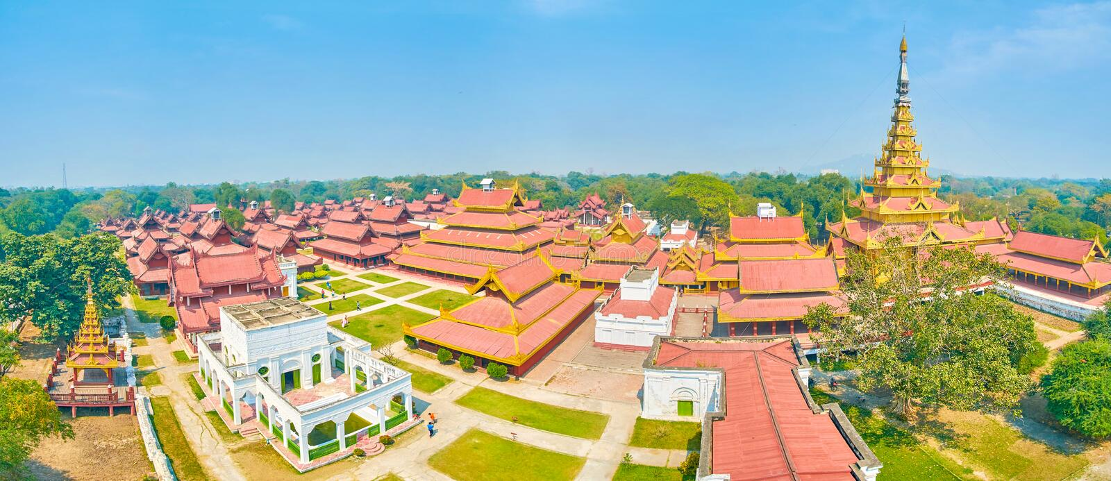 Panorama of Royal Palace in Mandalay, Myanmar. Panoramic view on Royal Palace in Mandalay with its beautiful oriental styled buildings and Golden Spire tower stock images