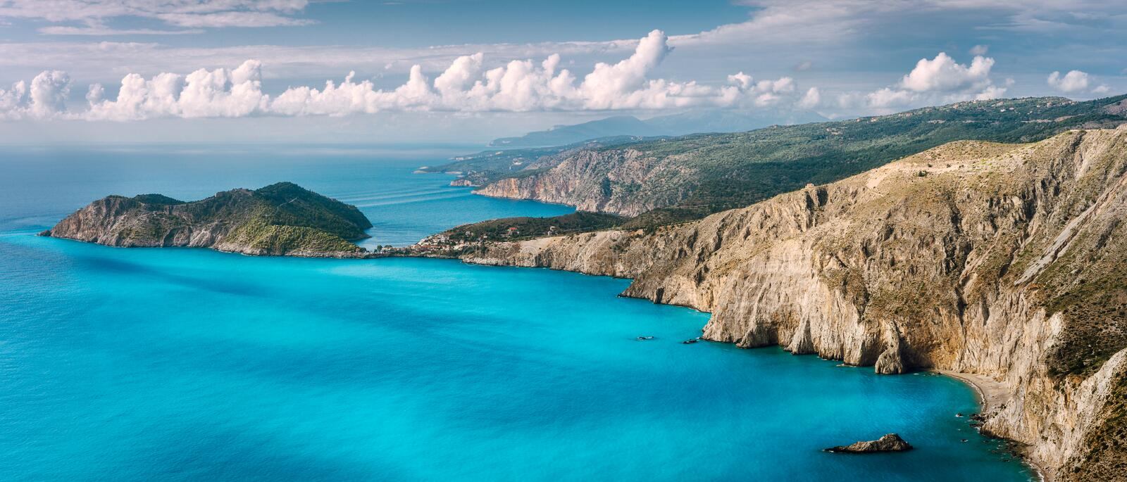 Panorama scenery view of Assos peninsula and coastline in Kefalonia Greece. Turquoise calm mediterranean water royalty free stock photography