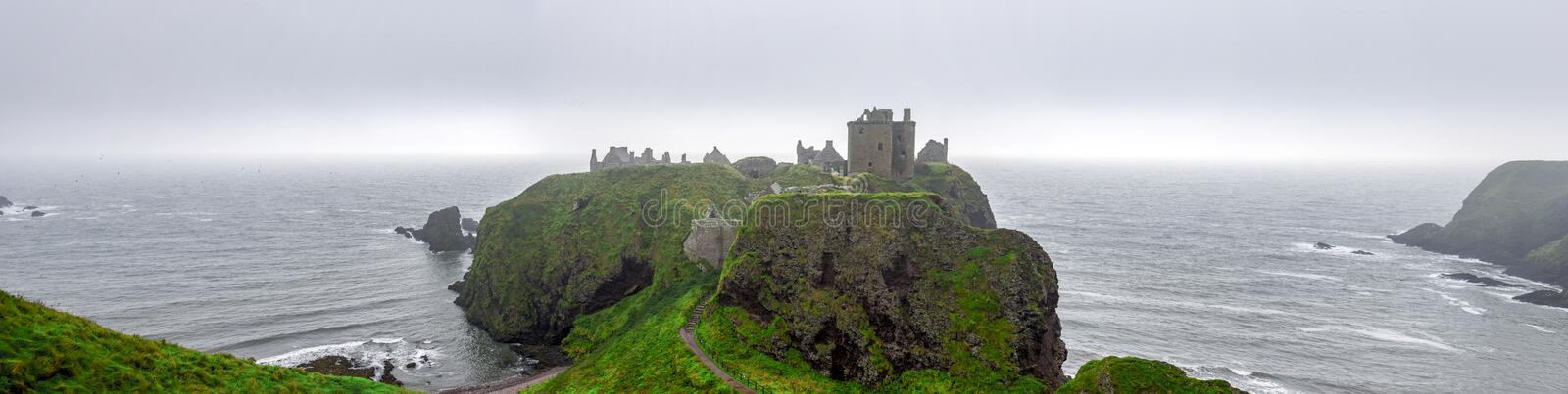 A panorama of scenic Dunnotar Castle and North Sea coastline in usual poor weather in Scotland, Aberdeenshire. A panorama of scenic Dunnotar Castle and North Sea royalty free stock photography