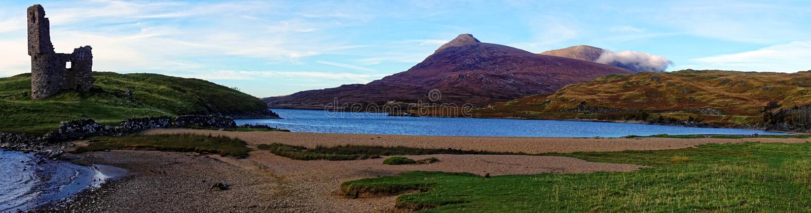 Panorama of Scottish Loch, Castle and Mountains stock photo