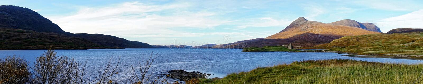 Panorama of Scottish Loch and Mountains. A highland Scottish loch and mountains in autumn stock photos