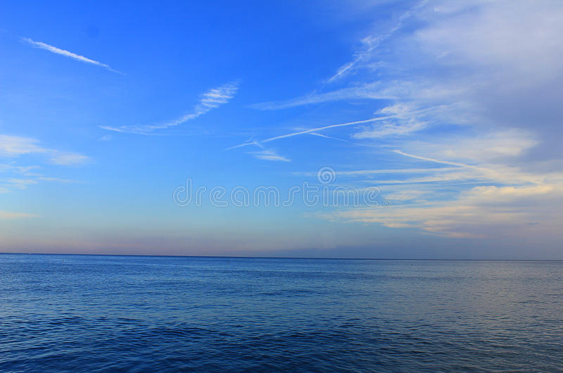 Panorama of the sea with clouds stock photo