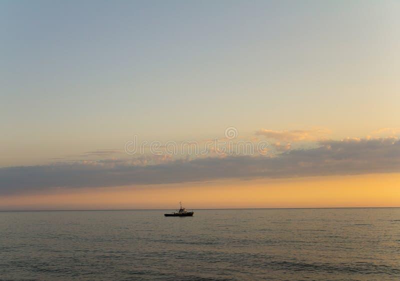 Panorama of sea sunset or sunrise a bright sky on the horizon ship royalty free stock photos