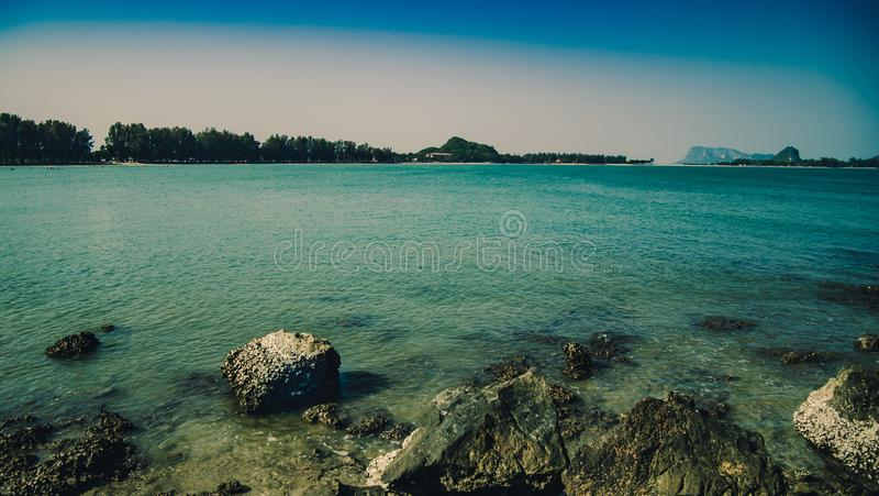 Panorama seascape natural dramatic blue color tone at Ao Manao Bay beach Prachuap Khiri Khan is a beautiful sea ocean in Thailand.  royalty free stock photography