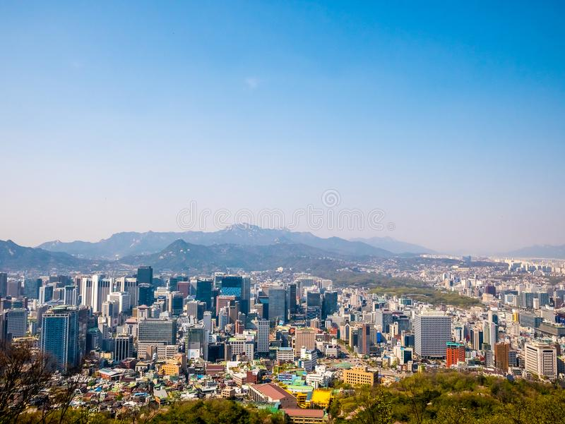 Panorama Seoul cityscape view from Namsan Hill.Blank space blue sky bacground. royalty free stock images