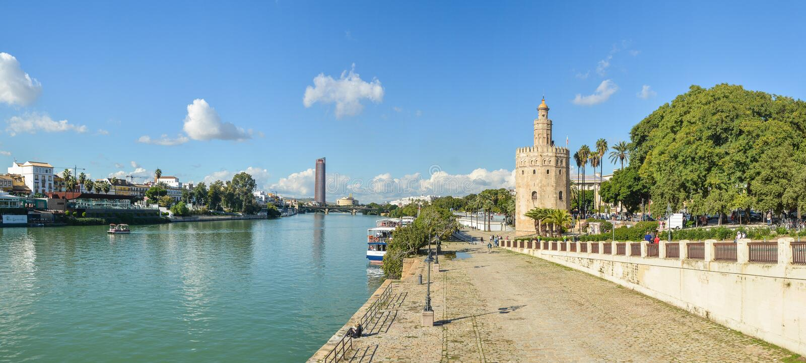 Panorama of Seville, the Golden Tower and the embankment. Of the river. Torre del Oro is one of the symbols of the capital of Andalusia in Spain royalty free stock images