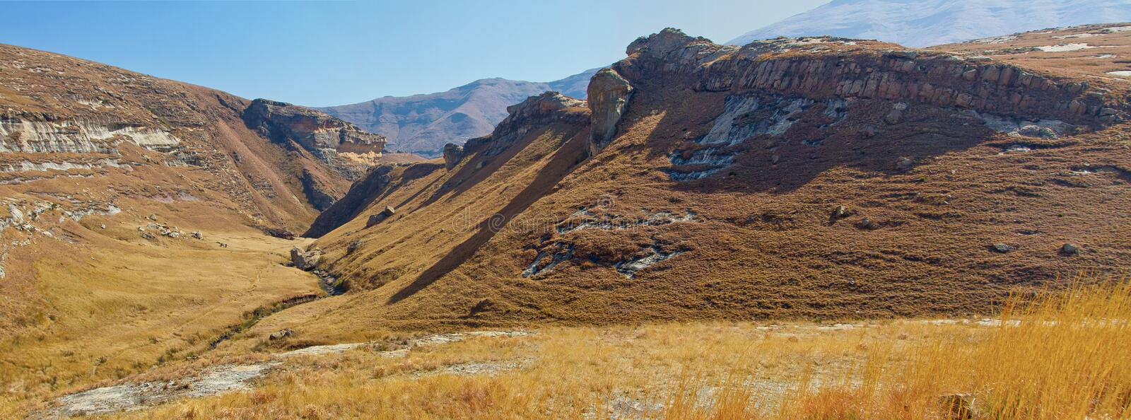 A panorama shot of the Drakensberg mountains at Golden Gate in the Eastern Free-state province in South Africa. Beautiful autumn/. The golden Gate National Park stock image