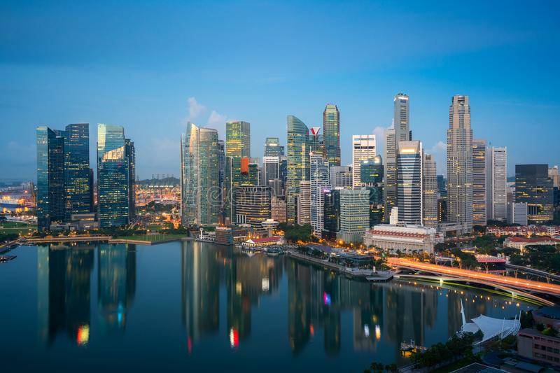 Panorama of Singapore business district skyline and skyscraper at twilight night at Marina Bay, Singapore. Asian tourism, modern royalty free stock photos