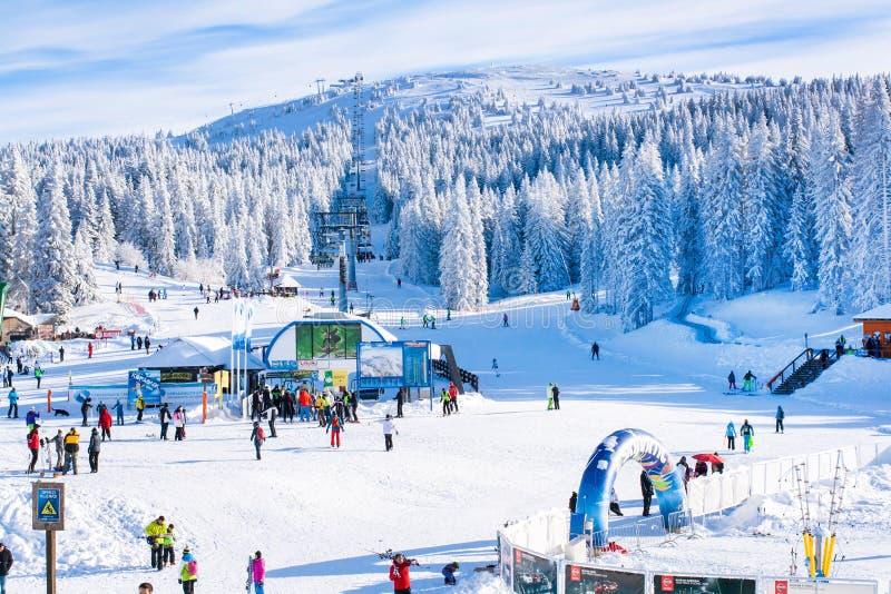 Panorama of ski resort Kopaonik, Serbia, people, lift, mountains. Kopaonik, Serbia - January 19, 2016: Panorama of ski resort Kopaonik, slope, people, ski lift royalty free stock image