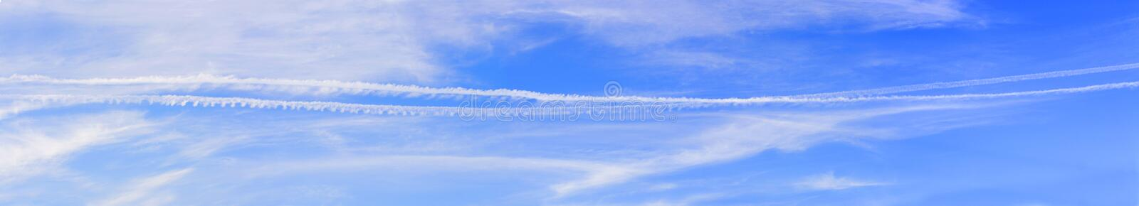 Panorama of the sky with beautiful clouds and traces of aircraft – a wide panoramic view in high resolution and high quality royalty free stock photos