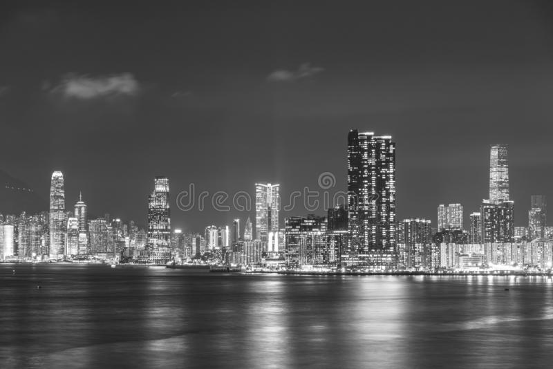Skyline of Victoria Harbor of Hong Kong city at night stock photo