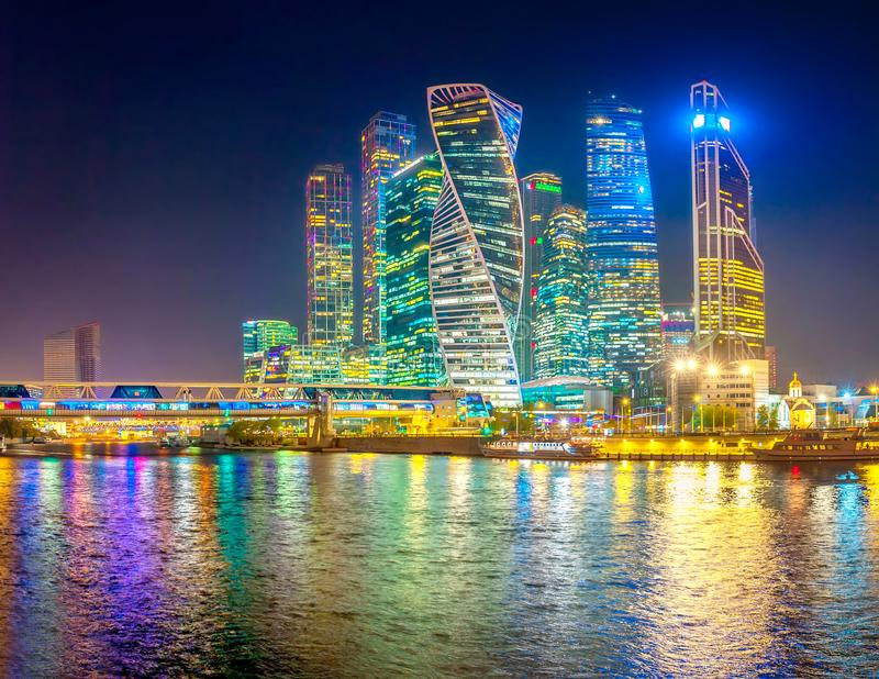 Panorama of Skyscrapers of Moscow City with reflections in Moscow river at night. royalty free stock photo