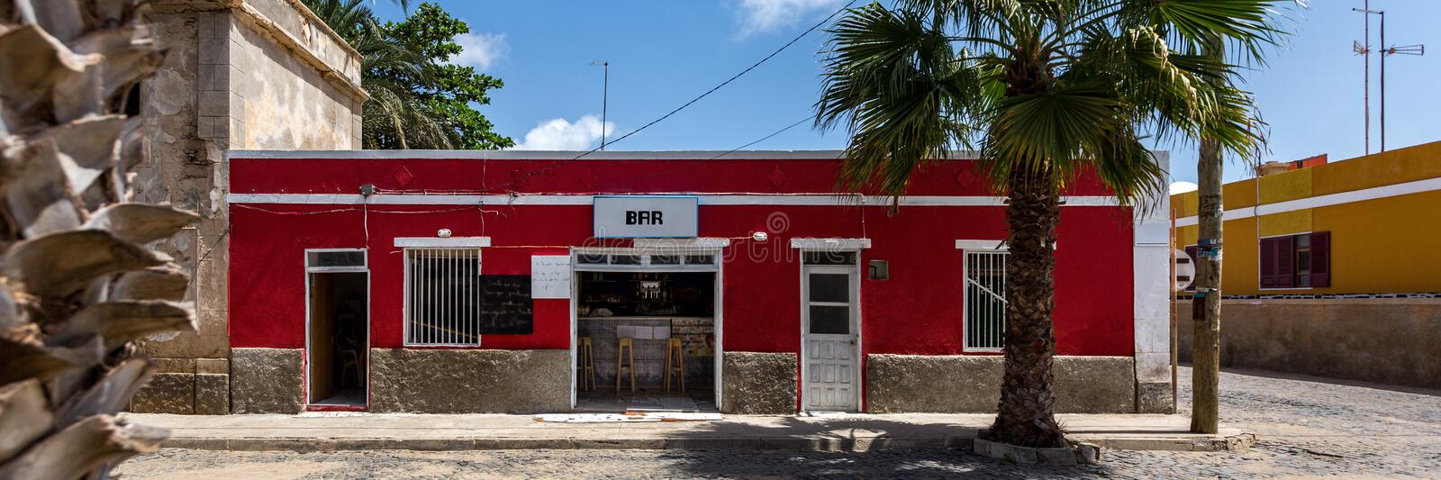 Colorful buildings and palm trees. Panorama of small colorful buildings surrounded by palm trees in Santa Maria, Sal, Cape Verde, Cabo Verde royalty free stock image
