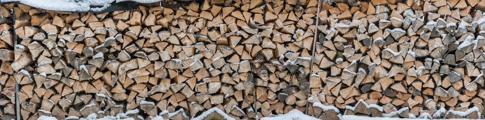 Panorama of snowy firewood as a background or texture royalty free stock photography