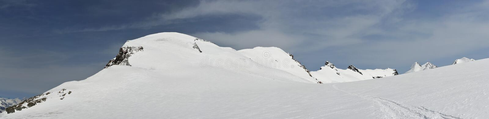 Panorama of snowy 4000-meter-peaks royalty free stock images