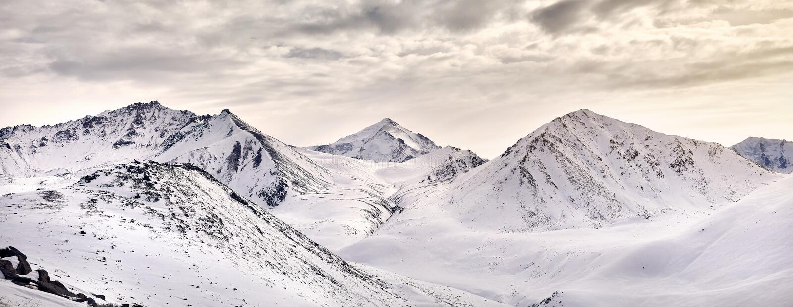 Panorama of snowy mountains of Kazakhstan stock images