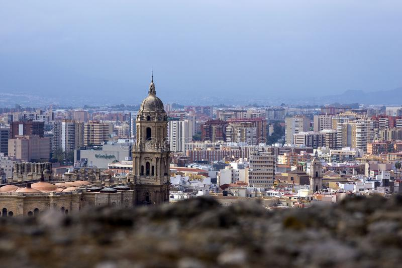 Panorama of the Spanish city of Malaga. Cathedral of Malaga. Buildings against a cloudy sky. Malaga, Spain, February 2019. Panorama of the Spanish city of stock photography