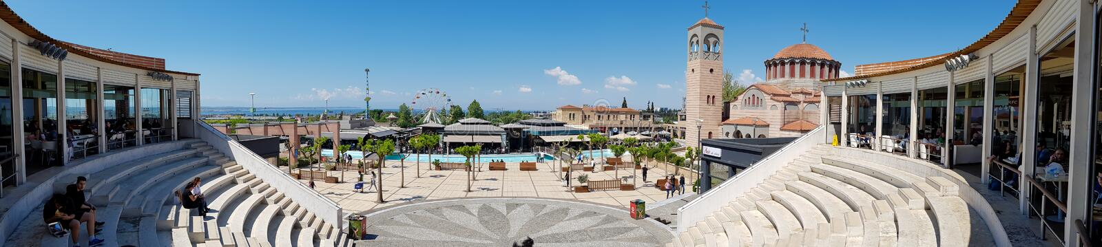Panorama of a square with pool and coffee shops outside of shopping mall in Thessaloniki,  Greece. royalty free stock image