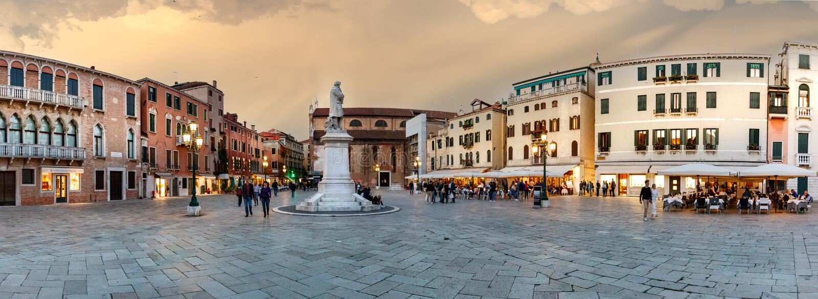 Panorama of the St. Stephen`s square and the statue of Nicolo Tommaseo in Venice at evening, Italy stock photo