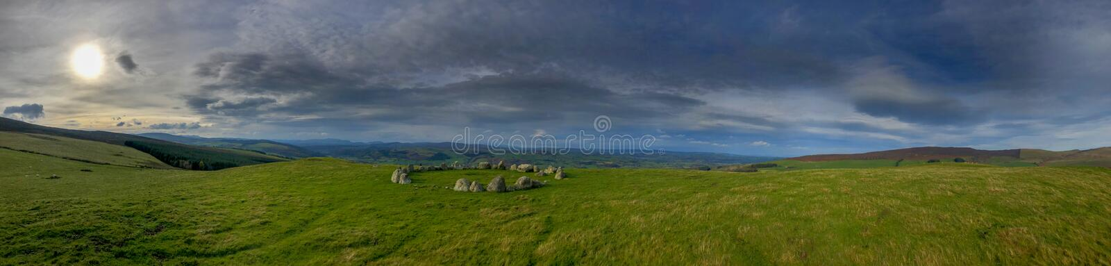 Panorama of stone circle Moel TÅ· Uchaf in Wales royalty free stock images