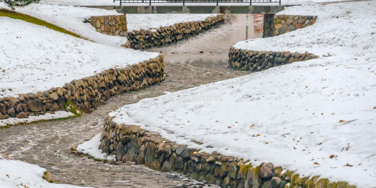 Panorama Stone lined creek on a park in Salt Lake City viewed on a frosty winter day royalty free stock images
