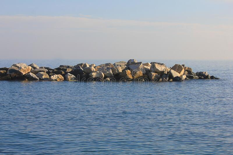 Panorama with stones and rocks in the sea royalty free stock image