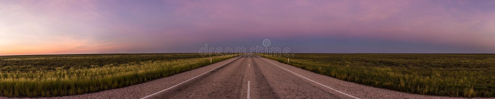 panorama of a straight road through the outback of Australia, after a beautiful sunset, Nothern territory stock images