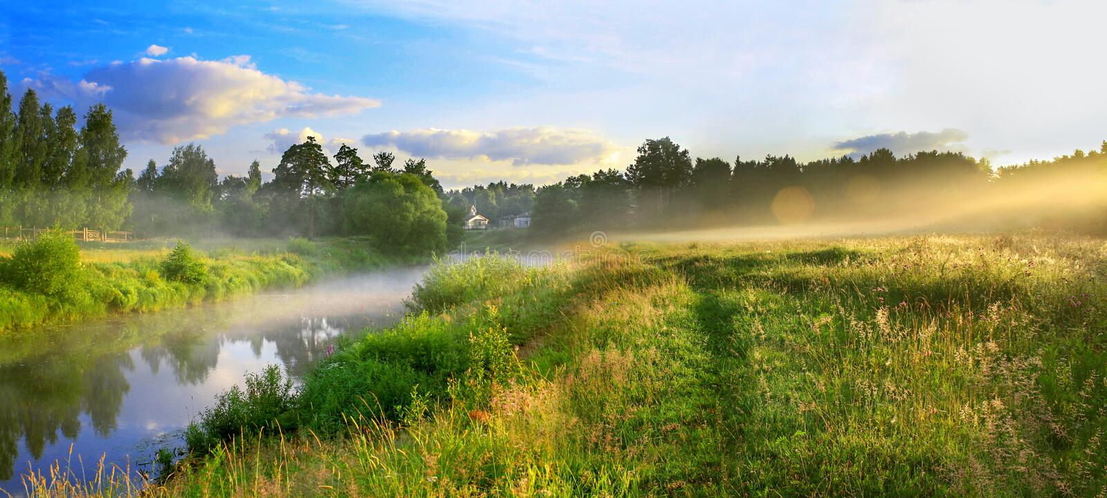 Panorama of a summer landscape with sunrise, fog and the river stock image