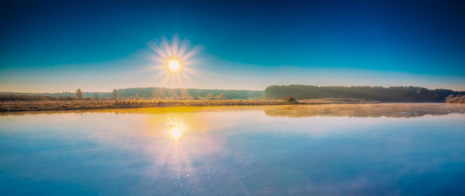 Panorama of sun rises over river. Autumn frost royalty free stock photography