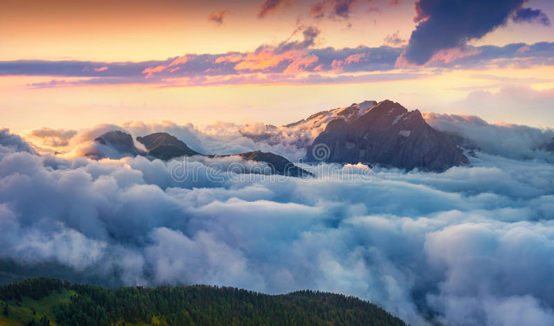 Panorama of the sunrise in foggy Val di Fassa valley stock images